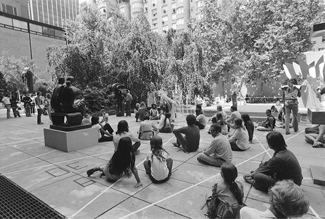 "Guests, participants, performers or guides, ""Interpenactors,"" at art happening, ""Interpenning,"" created by Marta Minujin, with technical assistant, Gary Glover. Summergarden Program, August 11, 1972. Photographic Archive. The Museum of Modern Art Archives, New York"