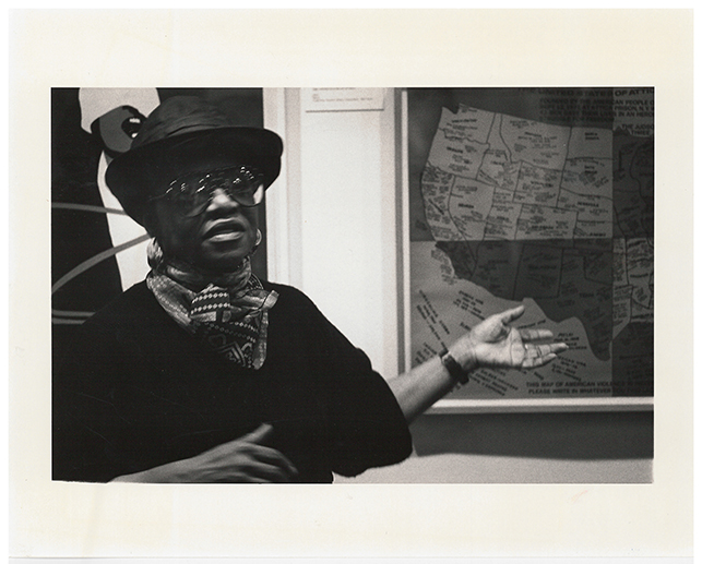 Artist Faith Ringgold speaking in front of her work, United States of Attica (1972), for the Gallery Talks By Artists series which formed part of the week-long Contemporary Art in Context program, March 4, 1988. Museum-Related Photographs, 213. MoMA Archives, NY
